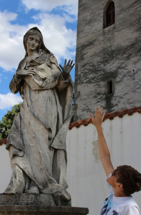 My son high-fiving the Virgin Mary
