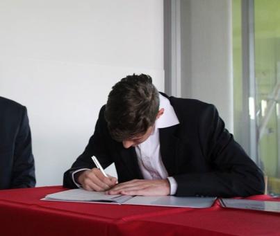 Signing diploma_edited