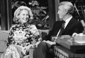 THE TONIGHT SHOW STARRING JOHNNY CARSON -- Pictured: (l-r) oFormer model Gloria Hatrick McLean with her husband and Actor Jimmy Stewart on February 15th, 1971-- (Photo by: Frank Carroll/NBC/NBCU Photo Bank)