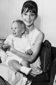 (Original Caption) One of Hollywood's brightest stars, Audrey Hepburn has a joyful reunion with her son Sean, three years old, upon his arrival from Los Angeles via TWA SuperJet at Idlewild Airport. Miss Hepburn just completed two motion pictures. Breakfast at Tiffany's and The Children's Hour.